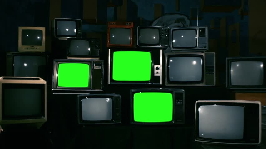 80s Televisions with Green Screens that Turn On. Blue Steel Tone. Zoom In. Ready to replace green screen with any footage or picture you want.  | Shutterstock HD Video #1010083607