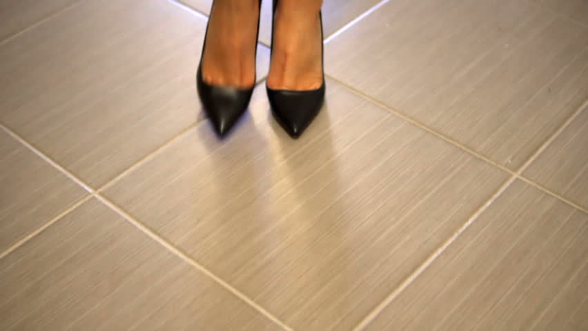 Tracking with low-section of businesswoman legs in high hills shoes walking along corridor tiles hallway, SLOW MOTION   Shutterstock HD Video #1010156087