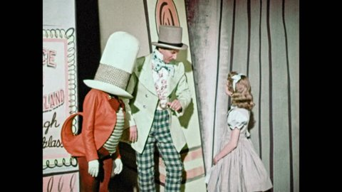 1950s: Little girl shakes hands with Mad Hatter and Jabberwocky. Mad Hater shoos the little girl away. The little girl looks confused but approaches the animated letters.