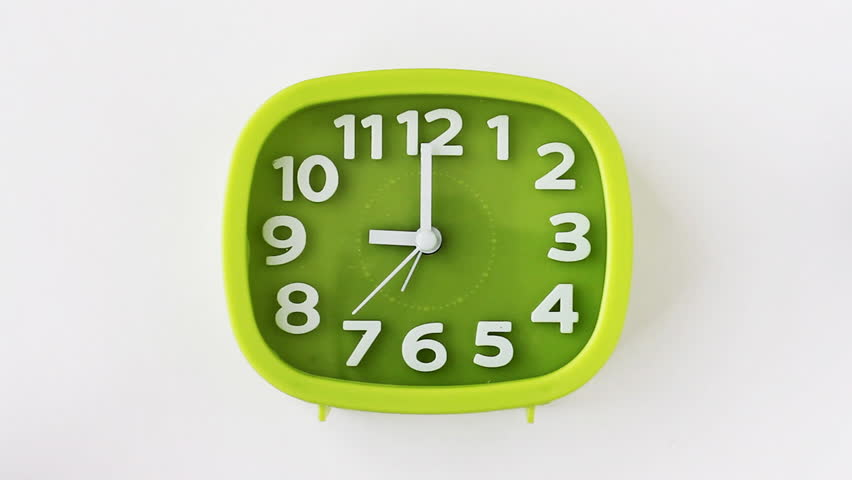 Green clock with white numbers and arrows on white background, Time Lapse | Shutterstock HD Video #1010211557