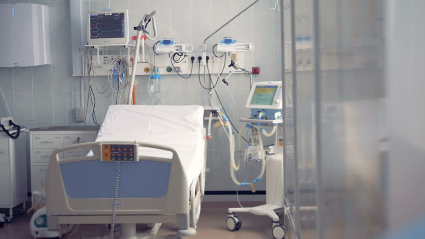 Empty hospital room with a bed and monitors. 4K. | Shutterstock HD Video #1010228597