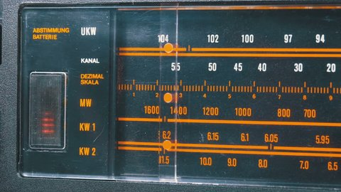 Tuning Analog Radio Dial Frequency on Scale of the Vintage Receiver. The frequency label moves in the range 89 - 108 MHz, and also over long, medium and short waves. Close-up.