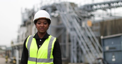 Portrait of female industrial worker on site