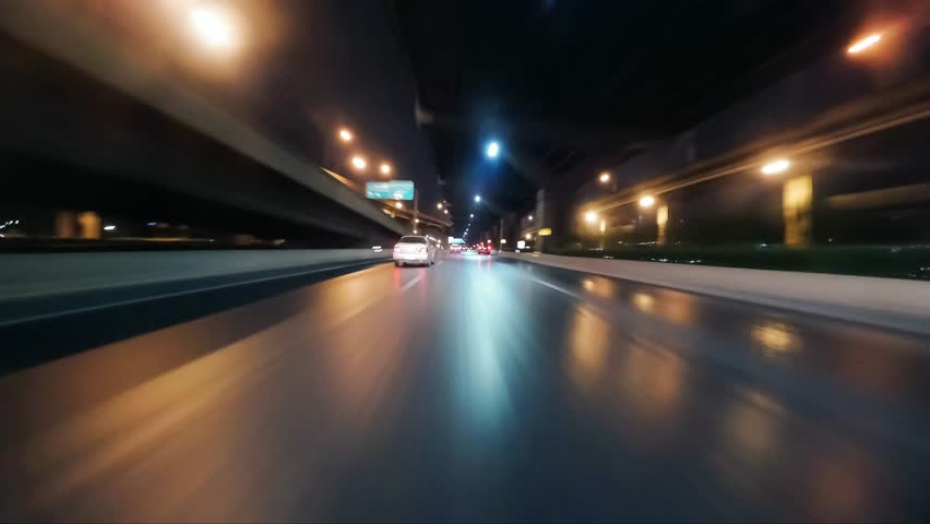 Time-lapse moving forward of road in city  with bridge at night, thailand. | Shutterstock HD Video #1010389697