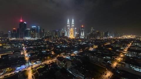 Time lapse: Night view of a Kuala Lumpur city skyline with busy light trails in Malaysia. 4k resolution