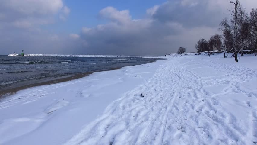 Aerial of Snowy Beach on Baltic Sea in Winter