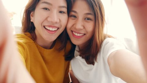 Beautiful young asian woman lesbian happy couple smile to the camera  LGBT lesbian concept.