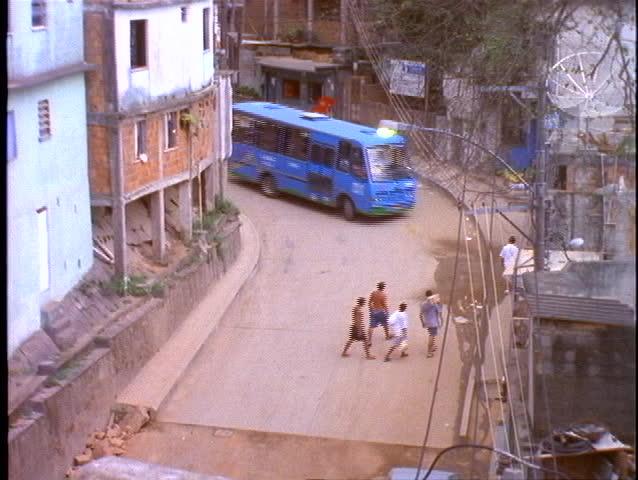 BRAZIL, 1998, Slums of Rio de Janeiro, favelas, on hillside, bus passes through