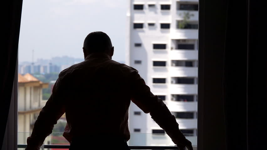 Man unveil curtains and admire view on balcony at home, super slow motion 240fps    Shutterstock HD Video #1010504597