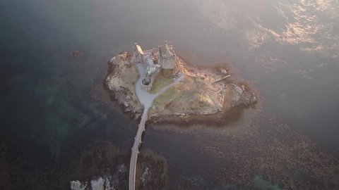 Top down aerial drone shot of Eilean Donan castle in the Scottish Highlands