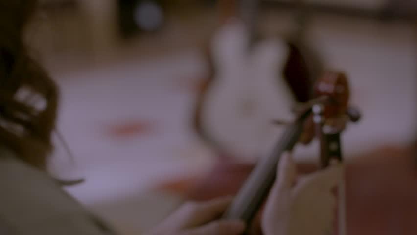 Female violinist adjusting her violin HD stock video. Alexa camera