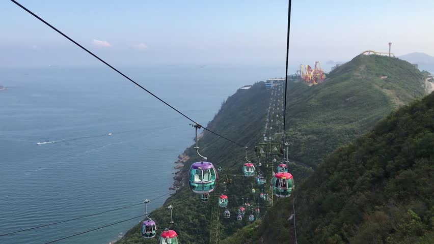 Beautiful scenery of mountain, island, sea, sky and many cable cars at Hong Kong Ocean Park.  | Shutterstock HD Video #1010554097