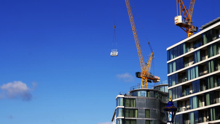 Urban growth. Construction site. Construction crane on background of blue sky