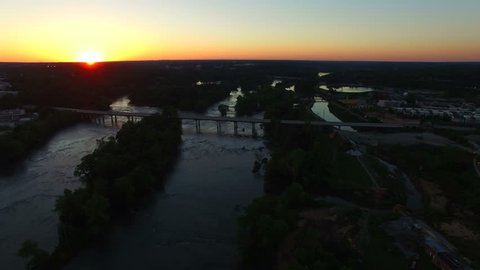 Sunset shot, slow drone flight across the Congaree River in Columbia South Carolina with a nice view of the Jarvis Klapman Bridge.