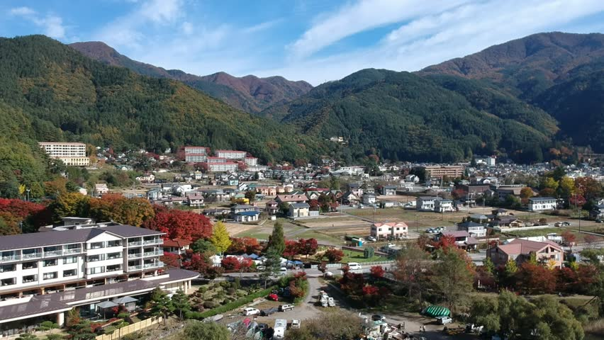 Fuji, kawaguchiko city and Lake from top view, fly video to Mt Fuji and Kawafujiko city, Japan by drone in first winter which lovely day clear sky and moutain of Fujisan. | Shutterstock HD Video #1010585087