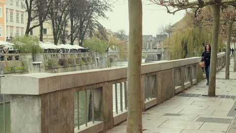 A beautiful girl with long hair walking along the river bank. Fashion. High definition video.