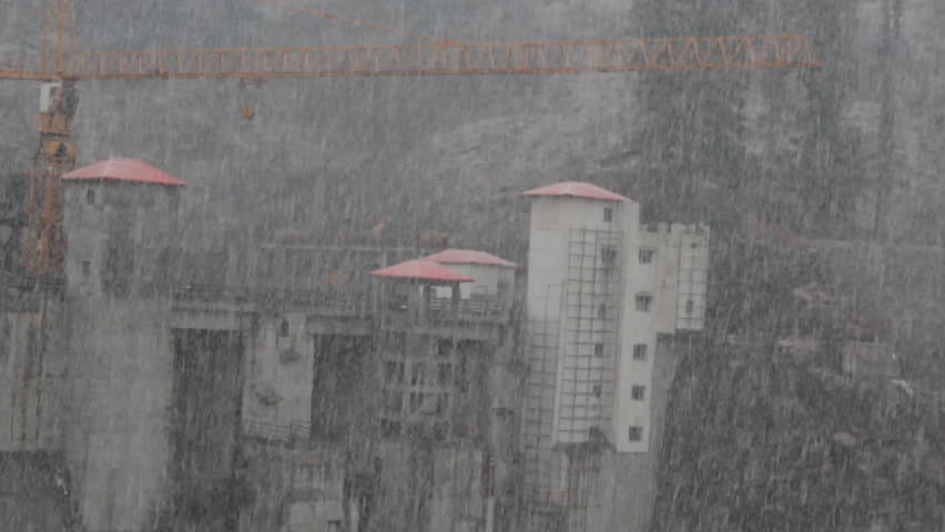 Construction of giant dam on river Parvati (hydroengineering complex, power plant). India. There is heavy continuous snow, spring period