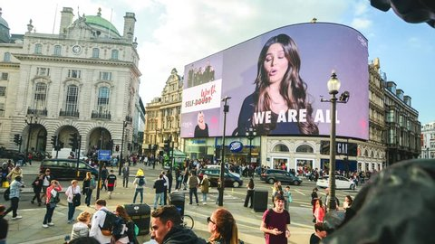 LONDON- MAY, 2018: Timelape of   Piccadilly Circus fountain and giant new advertising screen, a famous London landmark and busy destination for shoppers and tourists