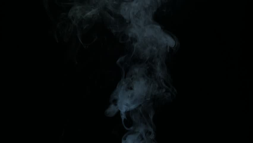 white smoke  on black bacground  blowing   from bottom to top