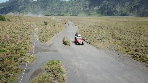 4K on Driving tracking to Mt.Bromo, Pasuruan, East Java, Indonesia. Adventure driving Off-road Jeep 4WD into Beautiful active Volcano with smoke Mount Bromo