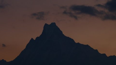 Annapurna base camp trek, Time lapse of view on the summit of the mountain Machapuchare (fish tail) at sunrise in Nepal.