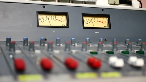 Control of sound levels on sound mixer console of professional audio equipment. Button front of powered mixer