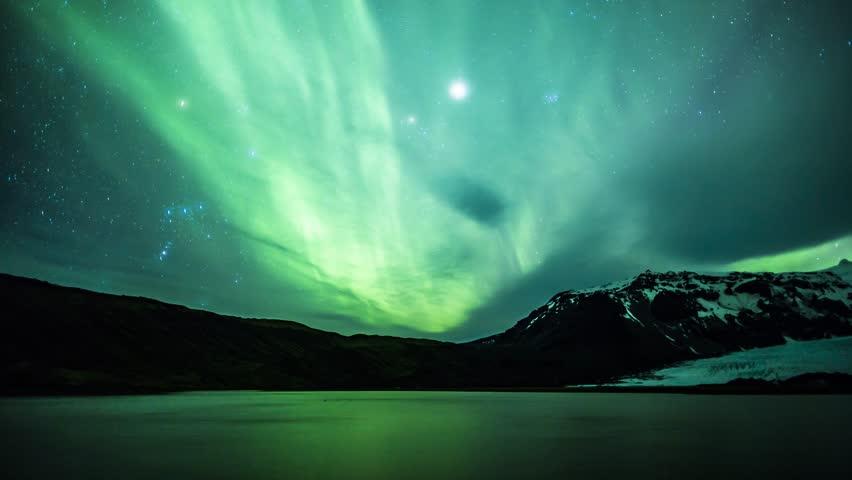 4K Aurora Borealis over a glacier lagoon lake | Shutterstock HD Video #1010746067