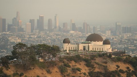 Sunset time lapse of Griffith Park Observatory. Day to night. Los Angeles cityscape, California.