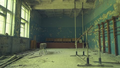 Abandoned gym hall in the school near to Pripyat. Chernobyl nuclear disaster. Slider shot - Juni 2017: 30km Chernobyl, exclusion zone