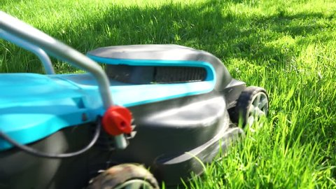 Lawn Mower is mowing the lawn