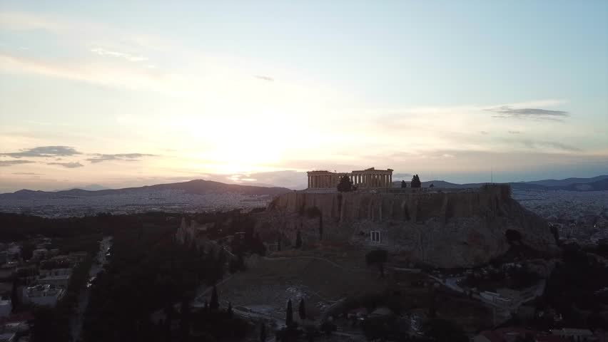 Aerial birds eye view video taken by drone of iconic Acropolis hill and the Parthenon at sunset with beautiful colours, Athens historic center, Attica, Greece | Shutterstock HD Video #1010850767