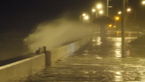 High Winds and Large Waves Pound A Coastal Town