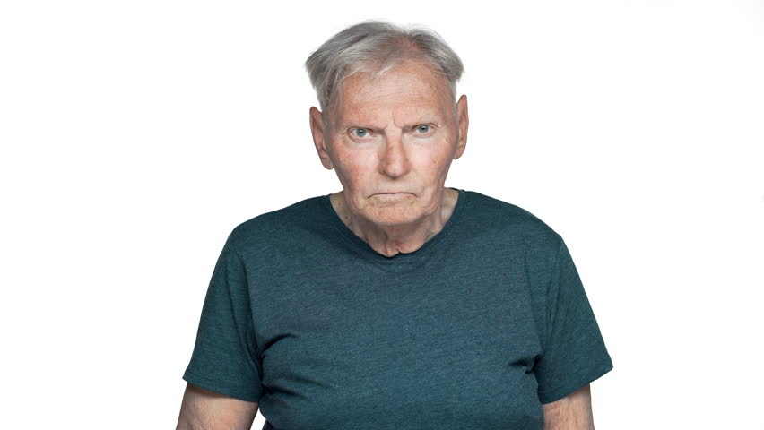 Portrait of dissatisfied old aged man 80s having gray hair in basic t-shirt posing with strict gaze and asking keep quiet putting index finger on lips, isolated over white background | Shutterstock HD Video #1010890637