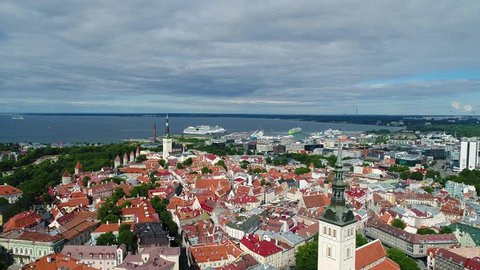 Aerial view of a drone slowly flying over Tallinn old town on sunny summer day. Tallinn, Estonia.