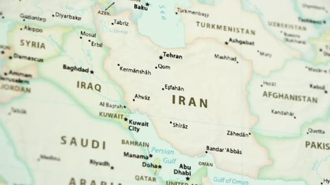 Iran on a political map of the world. Video defocuses showing and hiding the map.