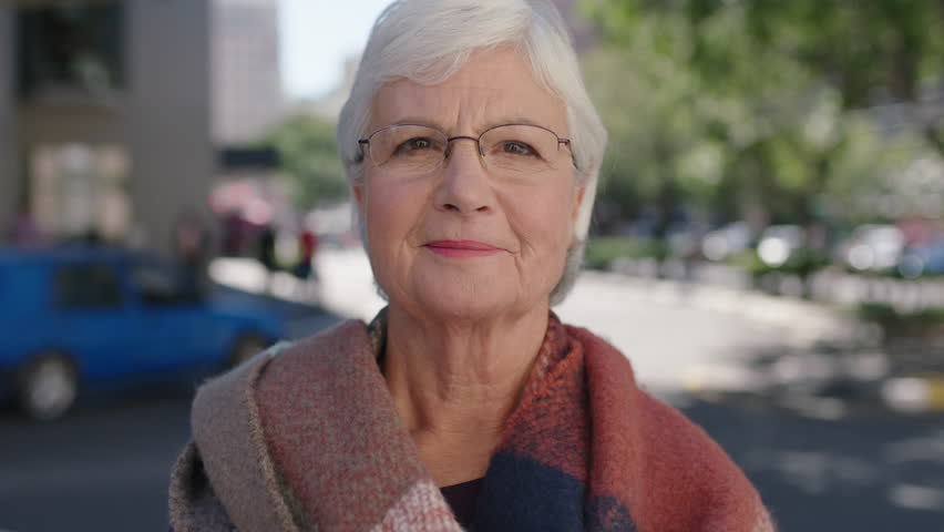 Beautiful portrait of elegant elderly woman laughing cheerful enjoying retired lifestyle healthy senior | Shutterstock HD Video #1010918387