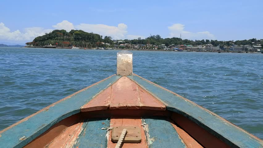 Sea transportation is Local Business in Ranong ; In the evening time with good weather local wooden boat in Ranong province, Thailand pick up passenger from Thai pier send to Kawthoung, Myanmar harbor