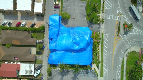 Aerial overhead pull out shot building tented for pest fumigation