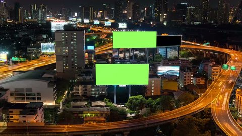 4K Time lapse: Billboard green screen with city night traffic lights background. Bangkok thailand. 4K Resolution.