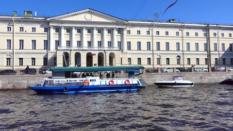 St. Petersburg / Russia - April 28 2018: View from riverboat slowly passing through canals of St. Petersburg, nice architecture and beautiful sunny day