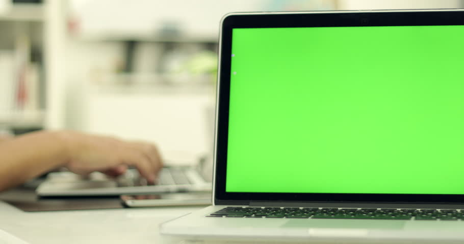 Green laptop computer screen set in front of workgroup #1011012257