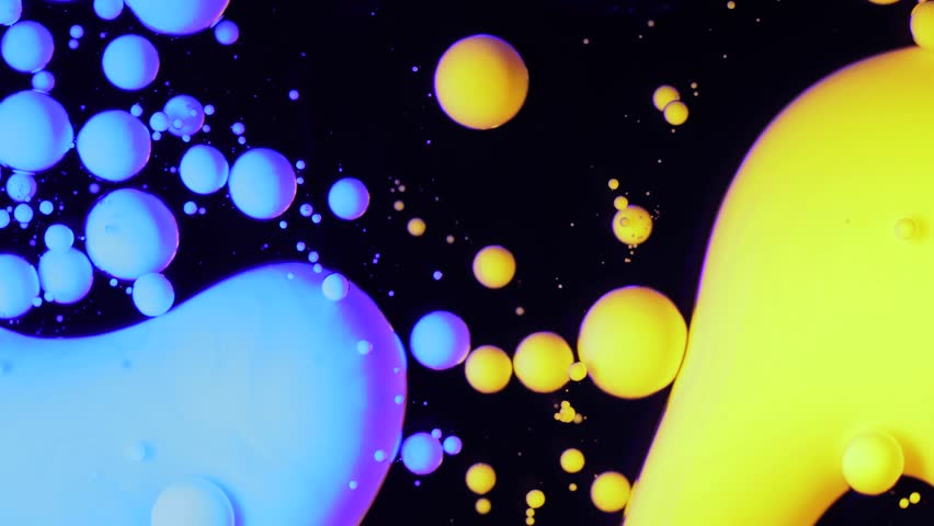 4K footage. Colorful liquid ink in water. Color abstraction. Bubbles paint in the water. Slow motion of paint in water. Multicolored Background Liquid Paint