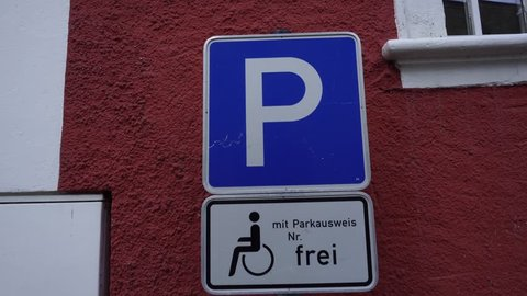Car parking road sign in Germany. Metal rectangle traffic sign with symbol letter P on pole. Information on board on German language With Pass Number Parking Is Free.