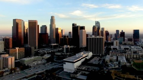 Drone shot of freeway traffic passing through downtown Los Angeles