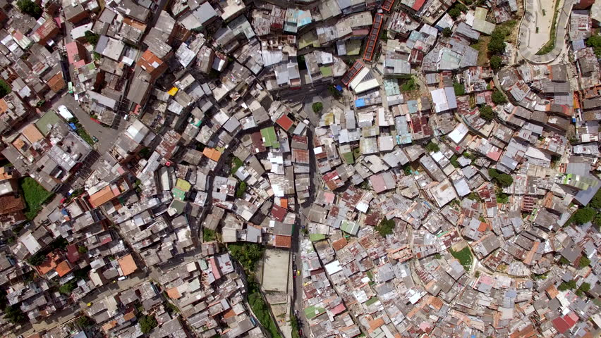 Medellin, Colombia, aerial top down view of Comuna 13 slums, once considered one of the most dangerous neighbourhoods in the world.