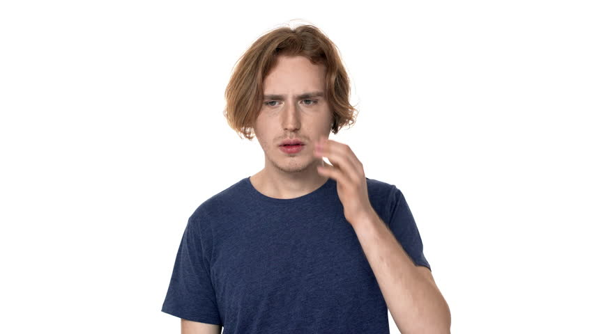 Portrait of sick unhappy man rubbing temples, and grabbing head because of headache or temperature over white background. Concept of emotions | Shutterstock HD Video #1011186197