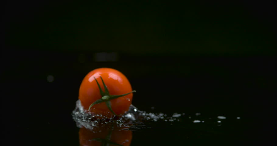 Tomato Rolling across water in slow motion. Shot with Phantom Flex.