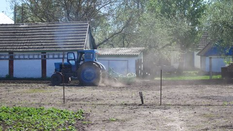 old vintage tractor plowing land