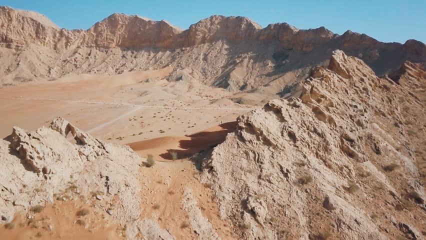 Beautiful mountain in Dubai desert. 4K video aerial | Shutterstock HD Video #1011201797