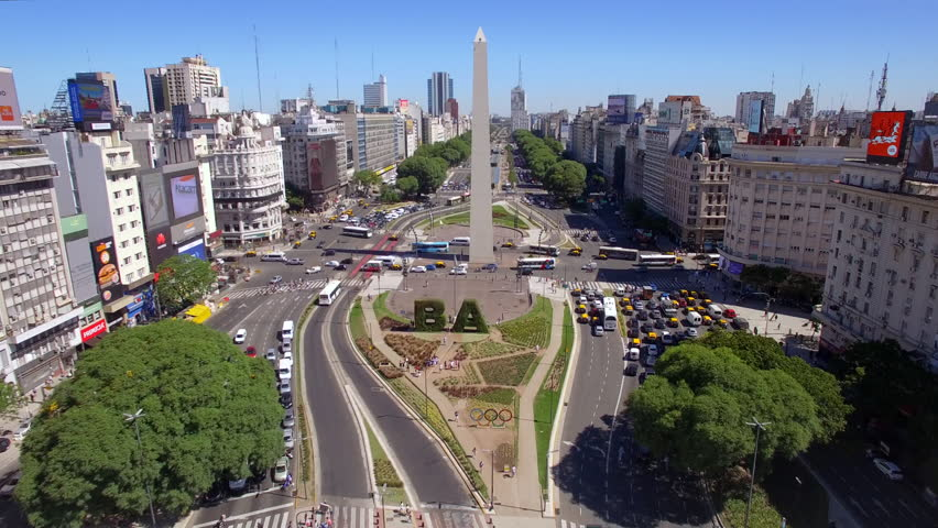 Buenos Aires, Argentina - January 9, 2018: Aerial view of the Obelisk of Buenos Aires and traffic on 9 de Julio Ave during daytime.